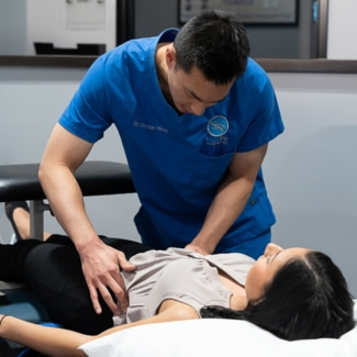 Woman getting prepped for Non-surgical Spinal Decompression Treatment at BackFit